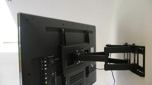 fixer tele au mur